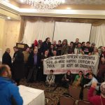 Syrians and supporters at Chicago meeting expressing solidarity with Boston bombing victims.