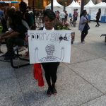 A participant in NMOS14 in Chicago. Photo for News & Letters by Franklin Dmitryev.