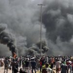 Crowds burn Burkina Faso parliament building, Oct. 30, 2014. Photo courtesy of The Speaker. https://www.flickr.com/photos/thespeakernews/15048526783/