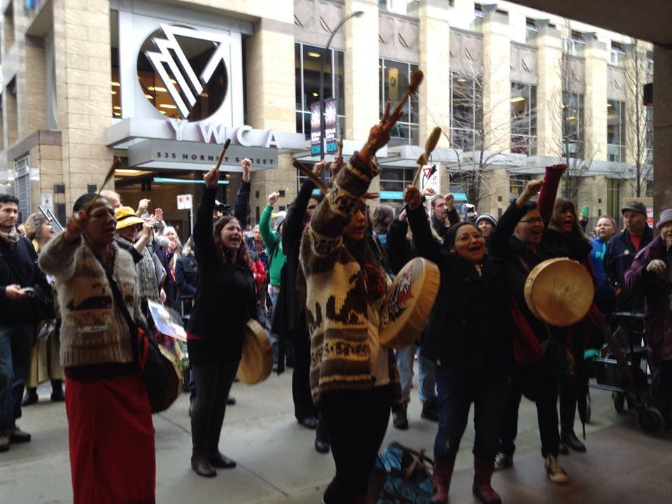 The Women's Warrior Song being sung outside of the Imperial Metals Office in Vancouver on Jan. 23, 2016 protesting fracking and oil pipelines. Photo by nathanmac87. facebook.com/unistoten/photos/786704024737178/
