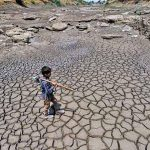 Child walking in dried up lake bed in Marathwada region of Maharashtra state, India.  Photo: India Mission