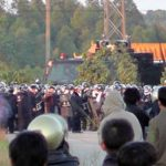 Villagers confront riot police in Wukan, Dec. 11, 2011. Photo: Wikipedia.com