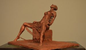 """Clay statue by Oula Haidar, inspired by Leila, a Syrian women who was tortured by the Assad regime and """"still hears a scream inside her."""""""