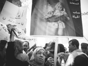 Demonstrators march in front of Yemen's parliament in Sana'a in 2010 protesting against child marriage. Photo courtesy of Afrah Nasser.