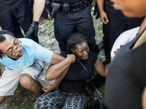 Protestors rough up Memphis protestors. Photo: Susanne Jackson