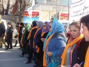 """Afghan women demonstrate on Feb. 13 in Kabul showing their opposition to violence against women. They chant: """"Justice! Justice!"""" and """"No more violence! Photo by Afghan Women's Network, www.afghanwomensnetwork.org."""
