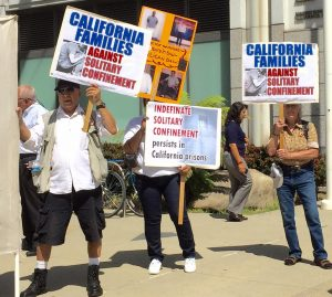 From left to right: prison activist Bato Talamantez, a family member of Victor Gallegos, and Penny Shoner stand up for California Families to Abolish Solitary Confinement during the Sept. 1 announcement of a settlement ending indeterminate use of solitary in California. Photo credit: Urszula Wislanka for News & Letters