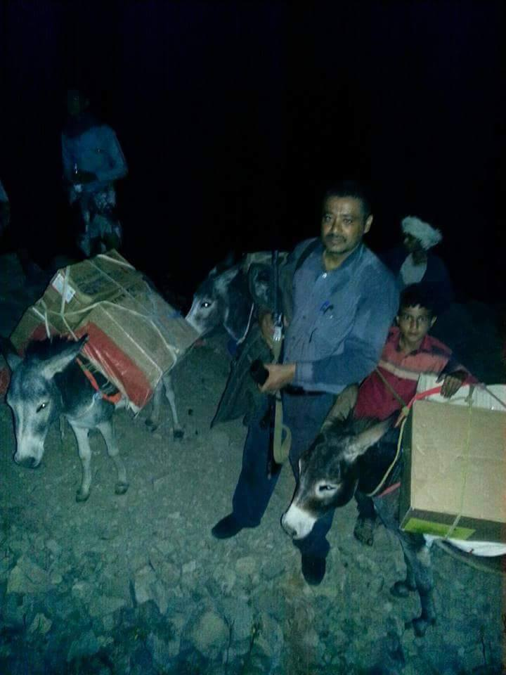 Smuggling supplies with donkeys at night.