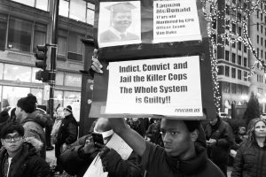 "Participant in ""Justice for Laquan"" rally and march in Downtown Chicago on Oct. 25, 2015. Photo credit to Frank James Johnson"