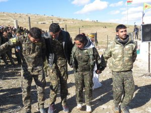 Men and women soldiers in Kobane celebrate on Jan. 25, 2016, the one year anniversary of the liberation of Kobane. Photo credit: Hawzhin Azeez.