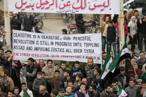 """The poster makers proclaim: """"Today, March 4, 2016, there were more than 100 protests all over Syria against Assad, he will never be part of future Syria. It feels great! #TheRevolutionContinues Photo: Kafranbel Syrian Revolution"""