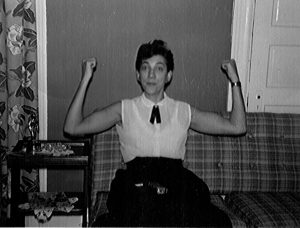 Olga Domanski flexes the muscles she built working in auto factories. News & Letters