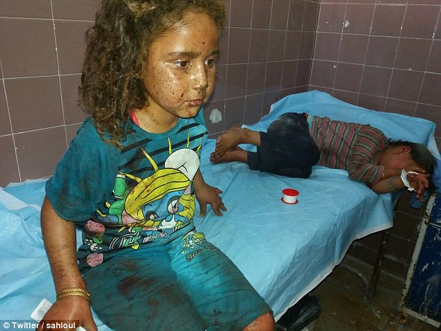 Children hospitalized after government bombing in Hama province, Syria. Photo by Zaher Sahloul, Syrian American Medical Society.