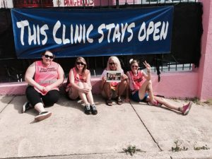 Clinic defenders like these at Mississippi's only surviving abortion clinic are preparing to fight anew against Trump's promised attacks on women's right to abortion and birth control. Photo courtesy of Clinic Vest Project.