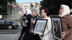 On May 17, 2017, Families for Freedom organized a sit-in outside the Palais des Nations in Geneva, Switzerland, to demand their loved ones be released. Fadwa is in the center (Photo: Families for Freedom)