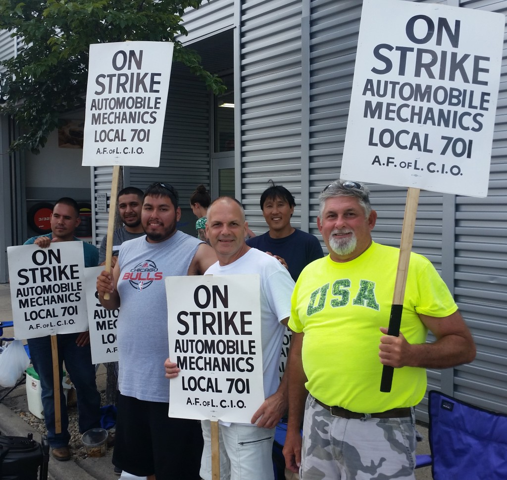 Auto mechanics on strike, picket line in Evanston, Ill., Aug. 14, 2017. Photo for News & Letters by Franklin Dmitryev.